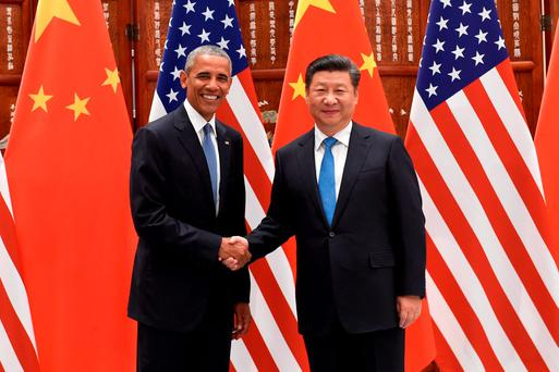 US president Barack Obama and Chinese president Xi Jinping shake hands before their meeting in Hangzhou, where security was intense and residents were encouraged to leave town Photo: Wang Zhao/Pool Photo via AP