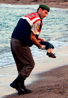 Crisis: One year ago the body of three-year-old Alan Kurdi was taken from the sea Photo: AP Photo/DHA