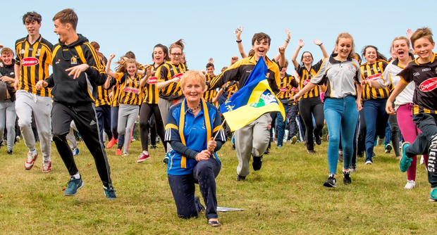 Passion: Mairead Frisby, from Tipperary, a special needs assistant at Grennan College in Thomastown, Co Kilkenny, with students in Cats colours ahead of today's All Ireland Hurling clash with Tipperary Photo: Dylan Vaughan