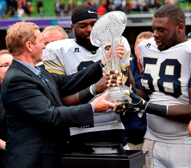 Patrick Gamble and Freddie Burden of Georgia Tech Yellow Jackets receive the trophy from Taoiseach Enda Kenny, after the Aer Lingus College Football Classic match between Boston College Eagles and Georgia Tech Yellow Jackets at the Aviva Stadium Photo: Brendan Moran/Sportsfile
