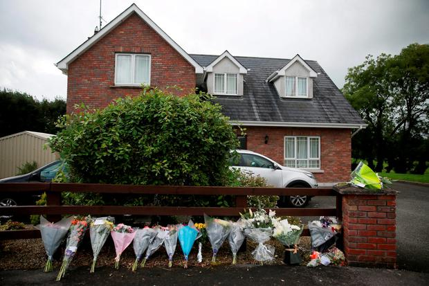 Floral tributes left outside the home of the Hawe family at Oakdene, in the townland of Barconey near Ballyjamesduff, Cavan Photo: Brian Lawless/PA Wire