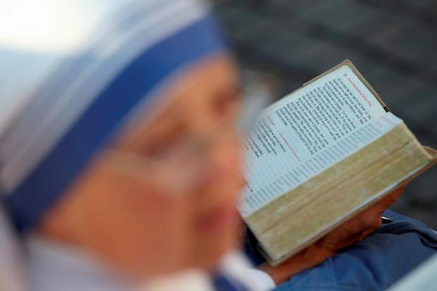 A nun, belonging to the global Missionaries of Charity, reads a breviary before a mass, celebrated by Pope Francis for the canonisation of Mother Teresa of Calcutta in Saint Peter's Square at the Vatican September 4, 2016