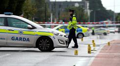 Members of the Garda Traffic Corps pictured at the scene where a lady was struck by a car on the Navan Road in Dublin. The lady later died. Picture Credit : Frank McGrath