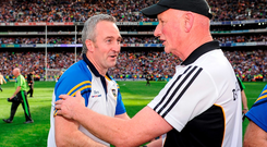 Tipperary manager Michael Ryan, left, is congratulated by Kilkenny manager Brian Cody