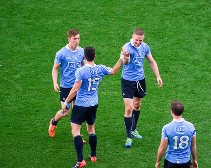 Dublin players, left to right, Con O'Callaghan, Bernard Brogan, Eoghan O'Gara, and Tomás Brady, celebrate after beating Kerry