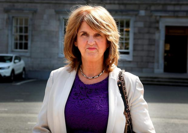 Joan Burton: debate will be a 'sham' without the full ruling. Photo: Tom Burke