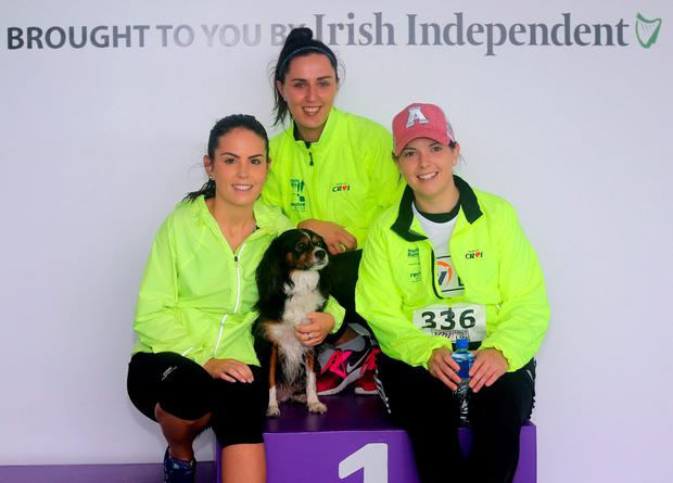 Olivia Caffey, Niamh O'Regan and Evelyn Caffey with Millie the dog at the 'Lust for Life' 5K race at the Galway Racecourse. Photo: Hany Marzouk