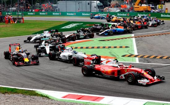 Ferrari's Kimi Raikkonen leads a packed field through the opening chicanes during the Italian Grand Prix at Monza yesterday. Photo: Getty