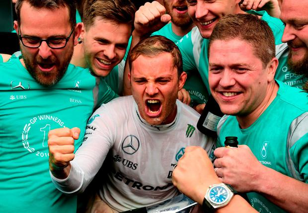 Nico Rosberg (C) celebrates with his team in the pit after winning the Italian Formula One Grand Prix. Photo: AFP/Getty