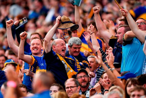 Tipp fans show their delight at the final whistle. Photo by Stephen McCarthy/Sportsfile