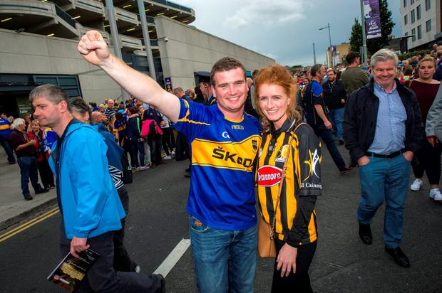 Daniel Luttrell and Aoife Corcoran support their counties. Photo: Doug O'Connor
