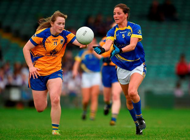 Tipperary's Anne O'Dwyer and Clare's Ailish Considine both chase the ball. Photo by Diarmuid Greene/Sportsfile