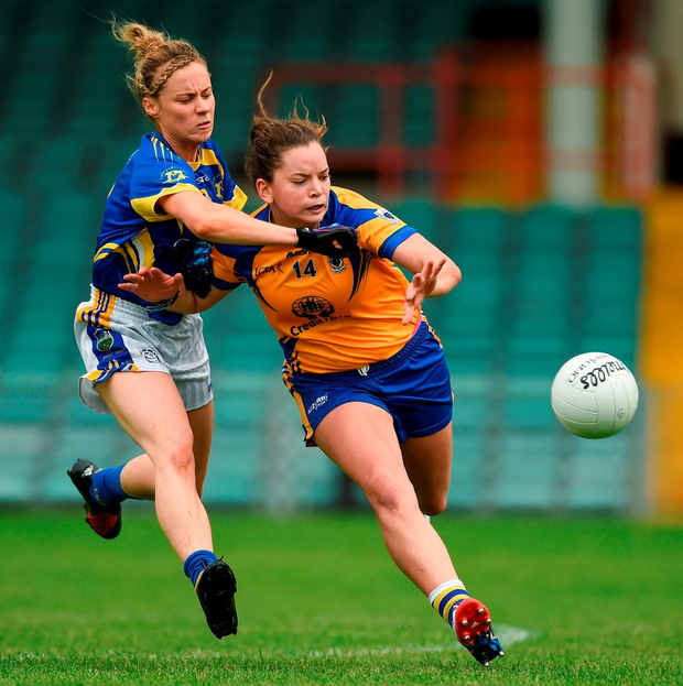 Clare's Niamh O'Dea contends with Tipp's Samantha Lambert for possession. Photo by Diarmuid Greene/Sportsfile