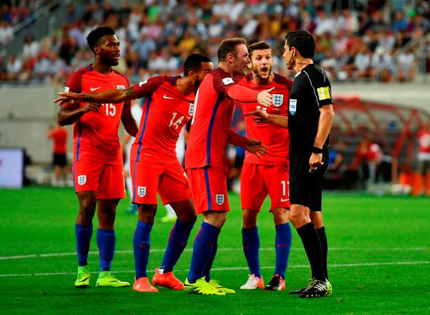 Theo Walcott of England (14) and team mates appeal to referee Milorad Mazic as Walcott's goal is disallowed. Photo by Dan Mullan/Getty Images