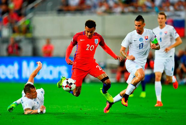 England's Dele Alli takes on Jan Durica (L) and Marek Hamsik. Photo: Getty