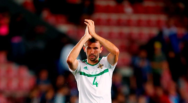 Gareth McAuley applauds the fans after the match. Photo: PA