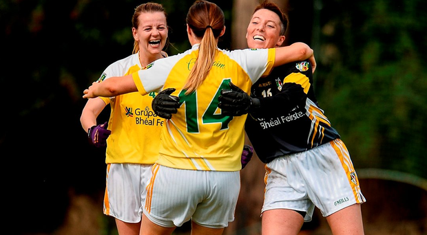 Antrim players Jenny McCavana, left, Eimer Gallagher and Christine Drain, right, celebrate their semi-final victory over London. Photo by Sam Barnes/Sportsfile