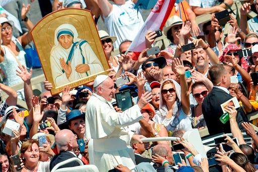 Pope Francis waves to faithful as he leaves after a Mass and the canonisation of Mother Teresa of Kolkata, on Saint Peter's Square in the Vatican. ANDREAS SOLARO/AFP/Getty Images
