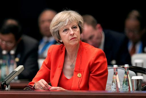 Warned: Theresa May. REUTERS/Nicolas Asfonri/Pool