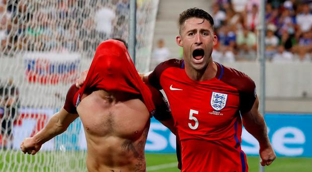 Adam Lallana celebrates with Gary Cahill after scoring a last-gasp winner for England against Slovakia in Trnava. Photo: Reuters