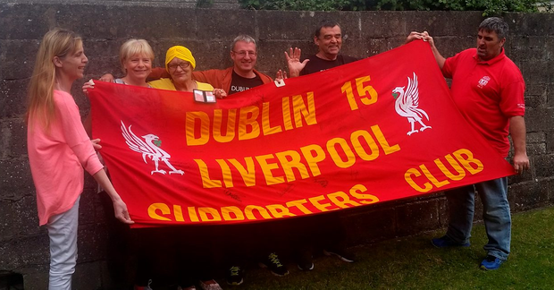 Marie Wright (in yellow) with members of the Irish Reds and LFC Dublin 15 supporters' clubs