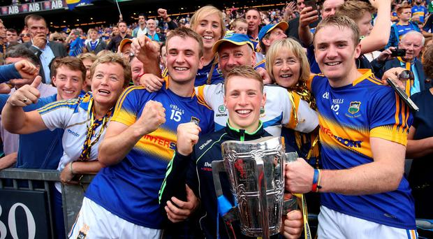 The inspirational McGrath brothers and their family celebrate Tipperary's comprehensive win over Kilkenny in the All-Ireland hurling final. John (left) scored Tipp's crucial second goal, Noel (right) picked up a second medal just a year after recovering from testicular cancer and younger brother Brian (centre) was the captain of the victorious minor team. Photo: Damien Eagers