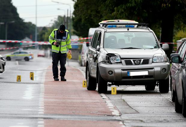 Member of the Garda Traffic Corps pictured at the scene where a lady was struck Picture: Frank Mc Grath