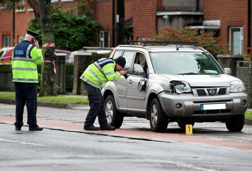 Members of the Garda Traffic Corps pictured at the scene where a lady was struck Picture Credit : Frank Mc Grath