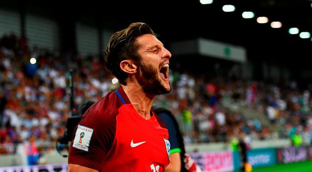 Adam Lallana of England as he scores their first goal during the 2018 FIFA World Cup Group F qualifying match between Slovakia and England at City Arena on September 4, 2016 in Trnava, Slovakia. (Photo by Dan Mullan/Getty Images)