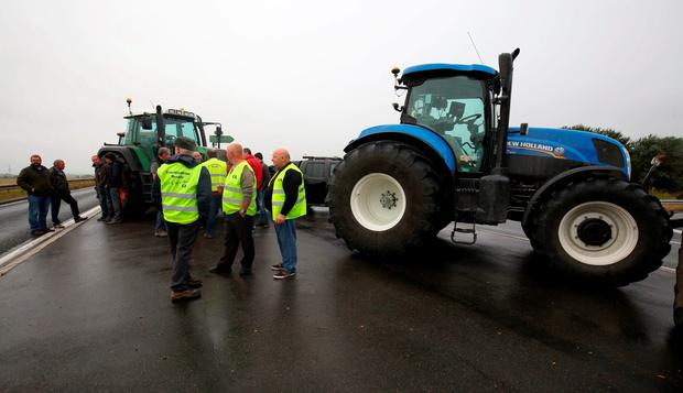 Tractors blockade a road near Calais, France, as part of a campaign for the Jungle migrant camp to be demolished Credit: Chris Radburn/PA Wire