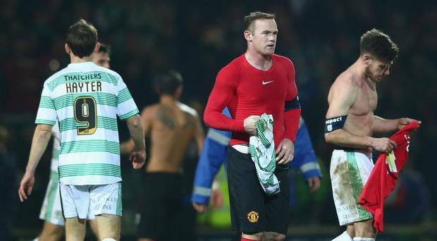 Joseph Edwards (R) of Yeovil Town swaps shirts with Wayne Rooney in the third round of the FA Cup. Getty