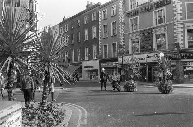 A guard stands on Grafton Street in September 1971 during the experiment phase of pedestrianisation to ensure no cars make their way down the street.
