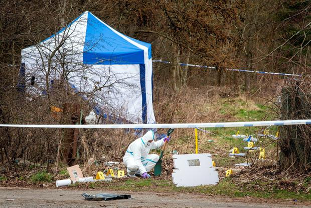 Police forensic officer at the site where the body of Paige Doherty was found near Great Western Road in Clydebank, as John Leathem, 32, has pleaded guilty at the High Court in Glasgow to murdering the 15-year-old schoolgirl. Danny Lawson/PA Wire