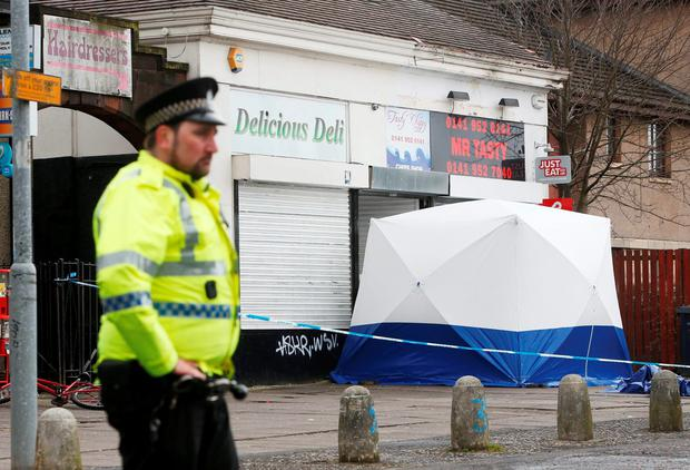 Police officer at a cordon outside the Delicious Deli in Clydebank, West Dunbartonshire, where murdered teenager Paige Doherty was last seen, as John Leathem, 32, has pleaded guilty at the High Court in Glasgow to murdering the 15-year-old schoolgirl. Danny Lawson/PA Wire