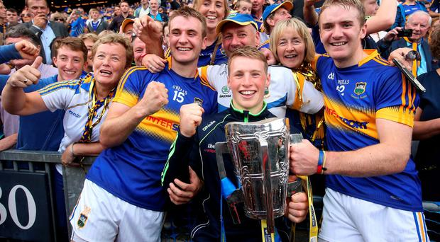 Tipperary's John McGrath, left, and Noel McGrath with their younger brother, Brian who was the winning minor captain, after victory over Kilkenny in the All Ireland Final at Croke Park. Picture credit; Damien Eagers 4/9/2016