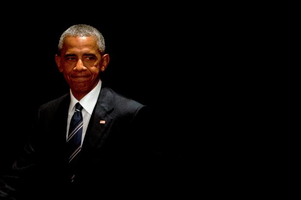 U.S. President Barack Obama steps out from behind a curtain screen as he arrives for a press conference after the conclusion of the G-20 Summit in Hangzhou in eastern China's Zhejiang Province, Monday, Sept. 5, 2016. (AP Photo/Mark Schiefelbein)