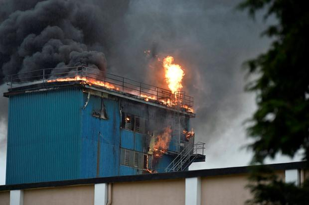 The fire at the roof of the plant