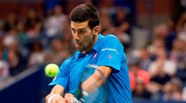 Novak Djokovic on his way to victory against Kyle Edmund. Photo: Don Emmert/AFP/Getty Images