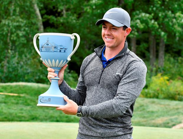 Rory McIlroy holds the trophy. Pic: Mark Konezny-USA TODAY Sports