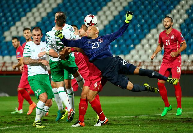 Darren Randolph and the Irish defence attempt to clear a cross. Photo: Reuters / Marko Djurica