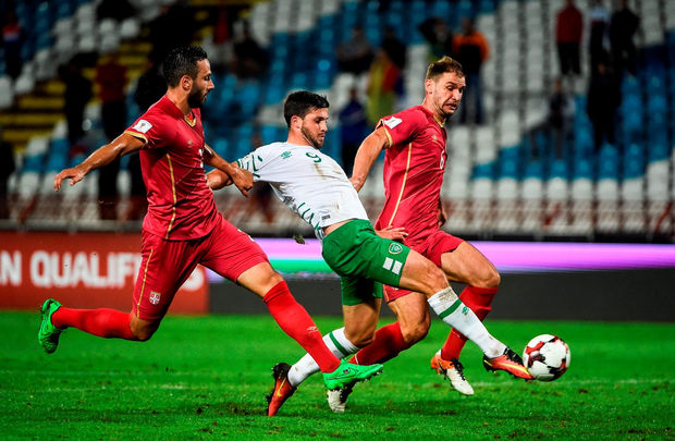 Shane Long of Republic of Ireland in action against Jagos Vukovic, left, and Branislav Ivanovic, far right. Photo by David Maher/Sportsfile