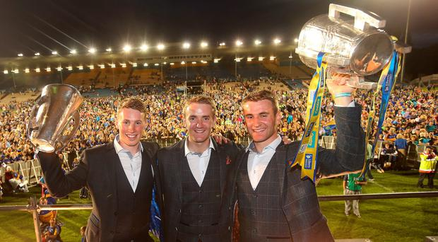 Brian McGrath, winning minor captain, with his brothers, senior players Noel and John, lifting the Liam MacCarthy cup at the homecoming last night. Photo: Damien Eagers