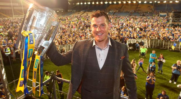 Seamus Callinan shows the trophy to the crowd. Picture credit; Damien Eagers