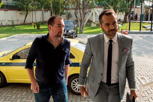 Kevin Mallon (left) arrives for questioning in Rio with his solicitor Franklin Gomes