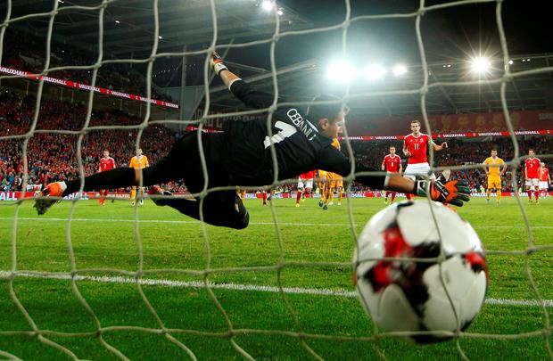 Wales' Gareth Bale scores their fourth goal from the penalty spot. Photo: Reuters / John Sibley