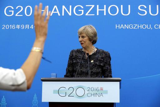Theresa May prepares to take questions at a news conference held at the end of the G20 summit AP