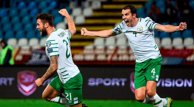 Daryl Murphy, left, and John O'Shea right, of Republic of Ireland celebrates the side's second goal during the FIFA World Cup Qualifier match between Serbia and Republic of Ireland at the Red Star Stadium in Belgrade, Serbia. Photo by David Maher/Sportsfile