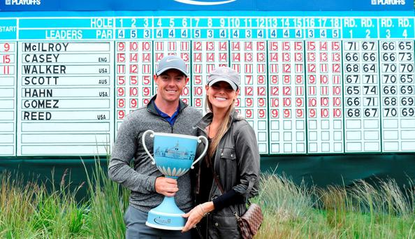 Rory McIlroy of Northern Ireland and fiancee Erica Stoll pose with the trophy during the final round of the Deutsche Bank Championship at TPC Boston in Norton, Massachusetts. (Photo by David Cannon/Getty Images)