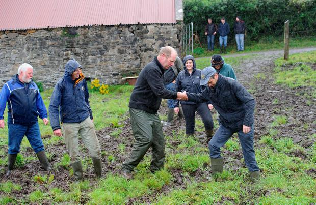 IFA President, Joe Healy getting a helping hand from George Anderson on his farm outside Laghey. Mr Healy met IFA members in Donegal who are struggling with bad ground conditions cut to the wet weather. Photo Clive Wasson