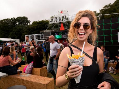 A reveller enjoying the sounds of Amsterdam in the Heineken Sound Atlas area at Electric Picnic